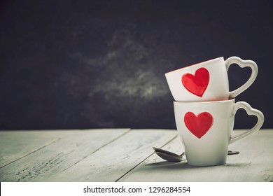 Valentine's Day concept. Red Cups on a Wooden Background.