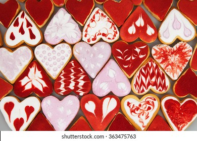 Valentine's day cookies. Heart shaped cookies for valentine's day.Red and Pink Heart Shaped Cookies. Valentine`s Day background. Romantic seamless pattern with cookies hearts.