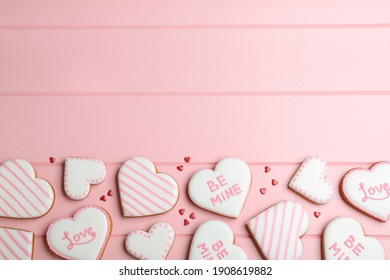 Valentine's day cookies on pink table, flat lay. Space for text