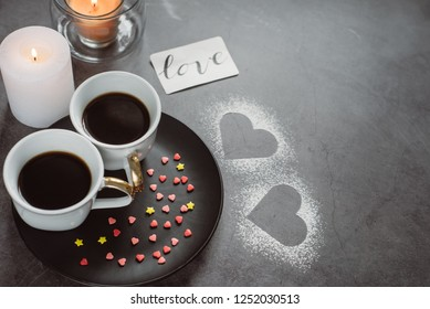Valentines day.Two  cup of coffee,  candle and heart on dark background. To the day of all the lovers