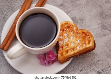 Valentine's Day. Cup with Coffee and Wafle Cake Heart Shape on Rustic Board