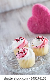 Valentines Day cupcakes with heart sprinkles and pink fuzzy heart