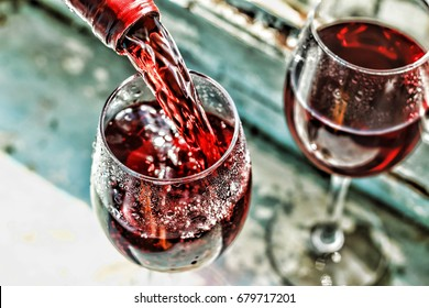 valentine's day, date, love, Celebration. pouring red wine. Wine in a glass, selective focus, motion blur, Red wine in a glass. Sommelier pouring the wine into the glass. Thanksgiving Day