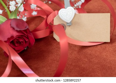 Valentine's Day declaration, declaration of love with a rose and a card