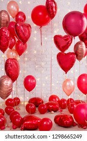 Valentine's day decoration - group of red circle and heart shaped balloons over white background