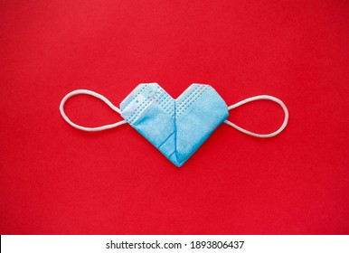 valentine's day during the coronavirus covid pandemic, 14 February 2021. medical mask valentine - Shutterstock ID 1893806437