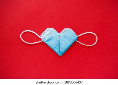 valentine's day during the coronavirus covid pandemic, 14 February 2021. medical mask valentine
