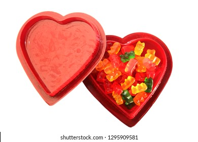 Valentines Day Edibles. THC and CBD infused gummy candies. Valentines Day Heart Shaped Box. Isolated on white. Room for text. Medical Marijuana. Recreational Cannabis.