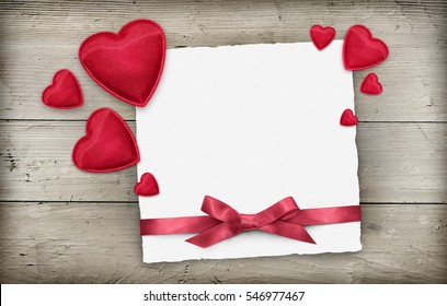 Valentines day empty greeting card with red hearts, ribbon over wood