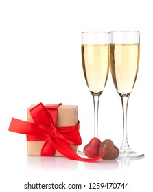 Valentines day gift box, chocolate hearts and champagne glasses. Isolated on white background