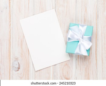 Valentines day gift box and greeting card on white wooden table with copy space
