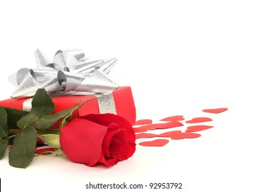 Valentines Day gift in red box with rose and small hearts isolated on white