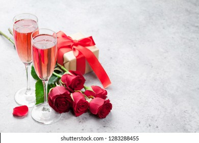Valentine's day greeting card with champagne, gift box and rose flowers bouquet. With space for your greetings