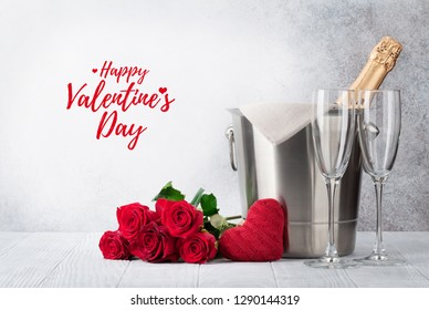 Valentine's day greeting card with champagne in bucket and rose flowers bouquet