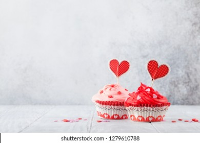 Valentine's day greeting card with delicious sweet cupcakes. With space for your greetings