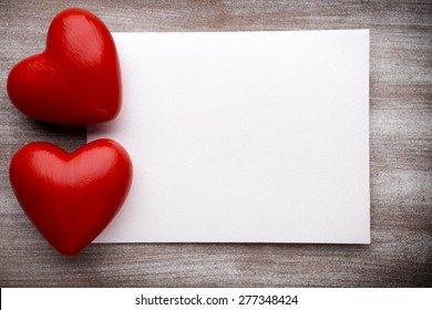 Valentine's Day greeting card. Heart on a wooden background.