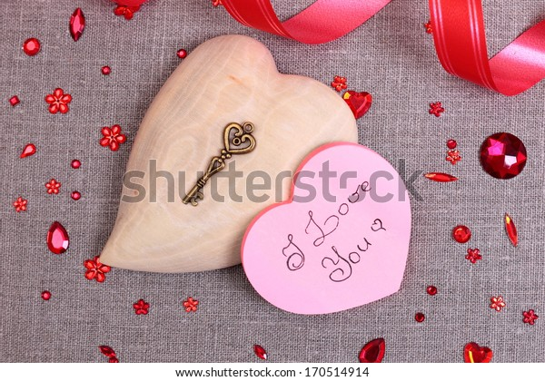 Valentine's day greeting card with heart symbol and decorations