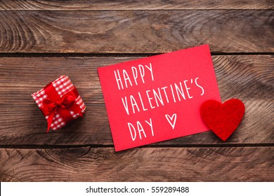 Valentines day greeting card small gift stock photo edit now valentines day greeting card and small gift heart decoration over wooden background valentines greetings m4hsunfo