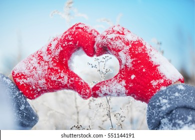 Valentine's Day, heart from hands, human making heart symbol with snowy hands, saint valentines day, girl hands in red mittens, boy, woman in red gloves in snow