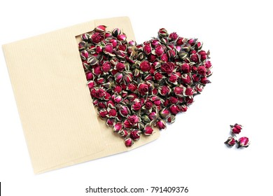 Valentine's Day. Heart from roses on a white background, top view