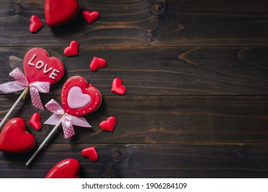Valentines day heart shaped cookies on wooden table background with copy space.