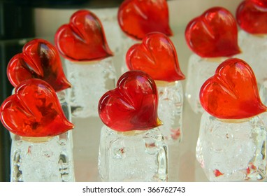 Valentines day hearts made of Murano glass, on white, ice like support.