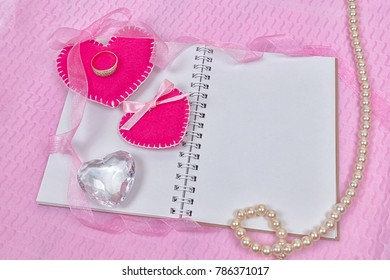 Valentines day hearts and notepad for your text. Top view on wooden table