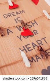 Valentine's Day hearts on a wooden wall with copy space. The inscription dream. Valentine's Day Card