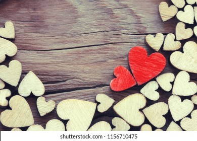 valentines day holiday background, border plywood heart on wooden table, vintage style, space for text