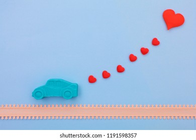valentines day holiday celebration with kinetic car figure and red heart on blue background