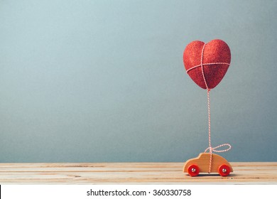 Valentine's day holiday celebration with toy car and heart shape