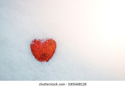 Valentine's Day. a holiday in winter, hearts in the snow. red hearts, frost street