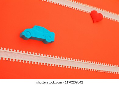 valentines day holidays celebration with kinetic sand car and  heart on red background