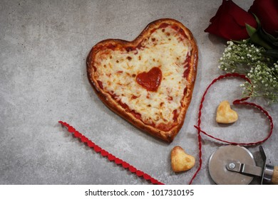 Valentines day Homemade Heart Pizza red roses ribbon  with copy space top view