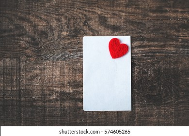 Valentines day image concept /  Valentine background with paper card for text and red heart