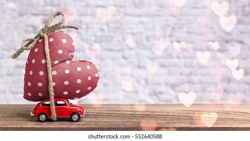 Valentines Day Incoming - Miniature Red Car Carrying Heart
