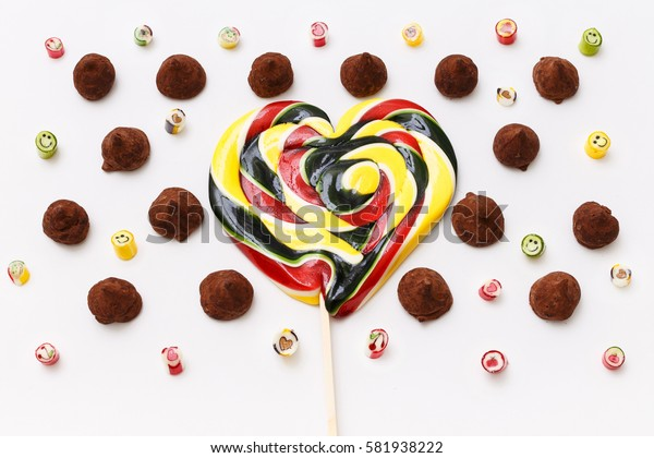 Valentines day lollipops, candy. Truffles pattern, top view flat lay of various chocolate pralines candy on white background. Chocolate Candy, Truffle.