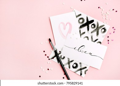 Valentine's Day or Love composition. Artistic concept with painted cards. Flat lay, top view.