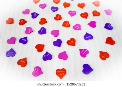 Valentine's Day. Love. A lot of hearts on a white background. Romantic decoration. Colorful little hearts for congratulations. Kisses, tender, friendship, gifts concept.