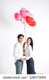 valentines day, love and people concept - happy couple with red heart shaped balloons, Roses, Big Red heart Paper over white background