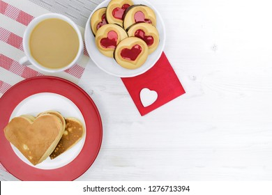 Valentine's Day. morning coffee with pastries and hearts