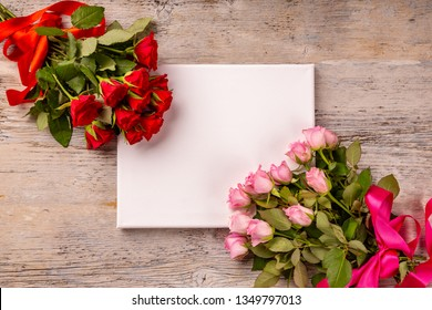 Valentines day or Mothers day greeting card and roses over wooden table