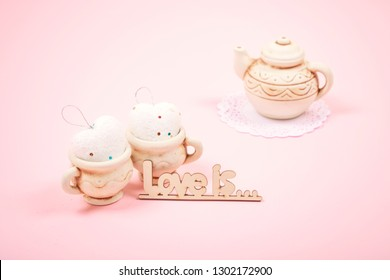 Valentines day pastel minimal background. Two clay cups with hearts and tea pot on a pink background. Wedding, elegant, Love, romance concept. Selective focus. - Shutterstock ID 1302172900