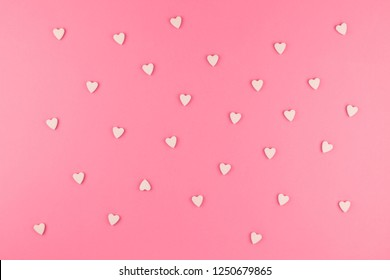 Valentines day pattern background flat lay top view of pink heart shaped candies scattered on pink background love wedding concept