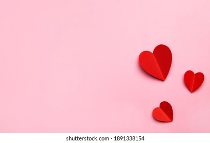 Valentine's Day pink background with red hearts shape. Copy space, space for text. Mockup template for design.