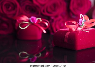 Valentines day present. Gifts and roses background concept.