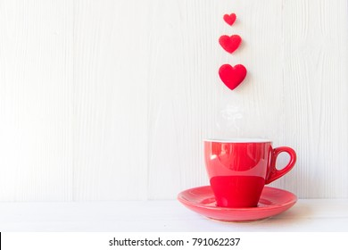 Valentine's Day with red cup coffee Sewed pillow hearts row border, wood white background, copy space  Valentine Concept.