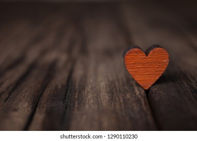 Valentines day red heart on old wooden background. Holidays card with copy space.