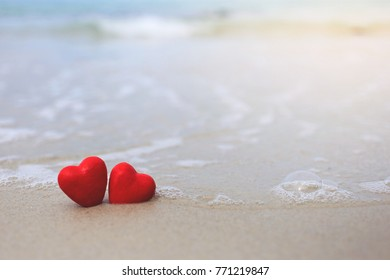 Valentine's Day Red Heart on a beautiful beach, vacation card with copy space.