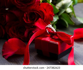 valentine's day Red roses and gift box on a wooden background